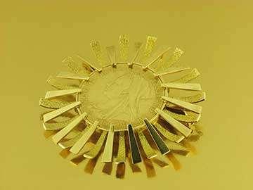 medallón oro Compro Oro Santander